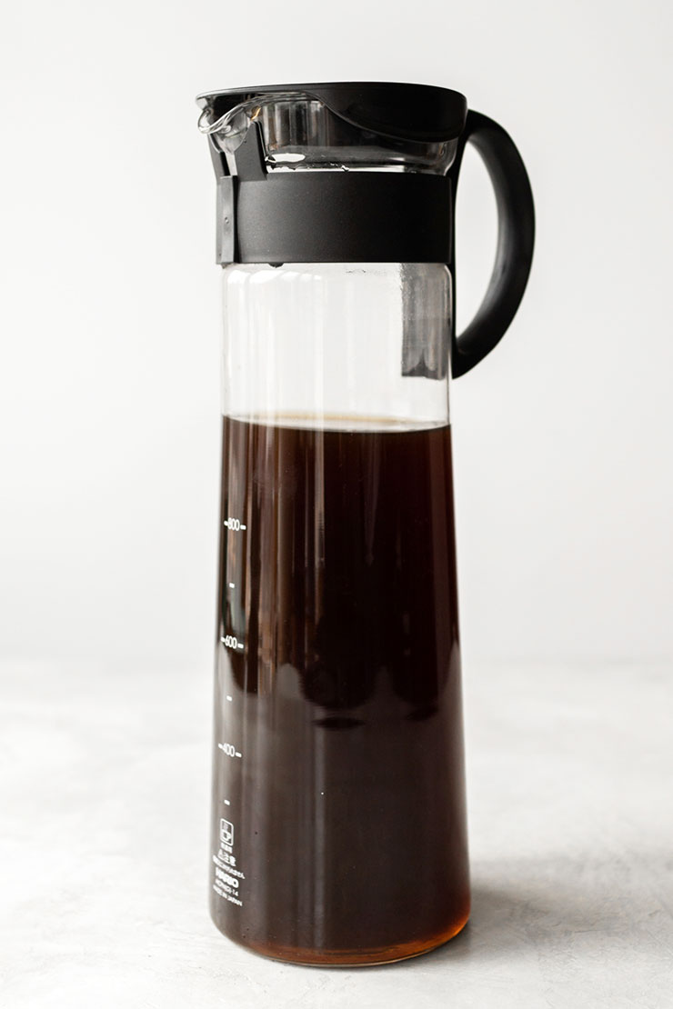 Cold brew coffee in a glass pitcher.