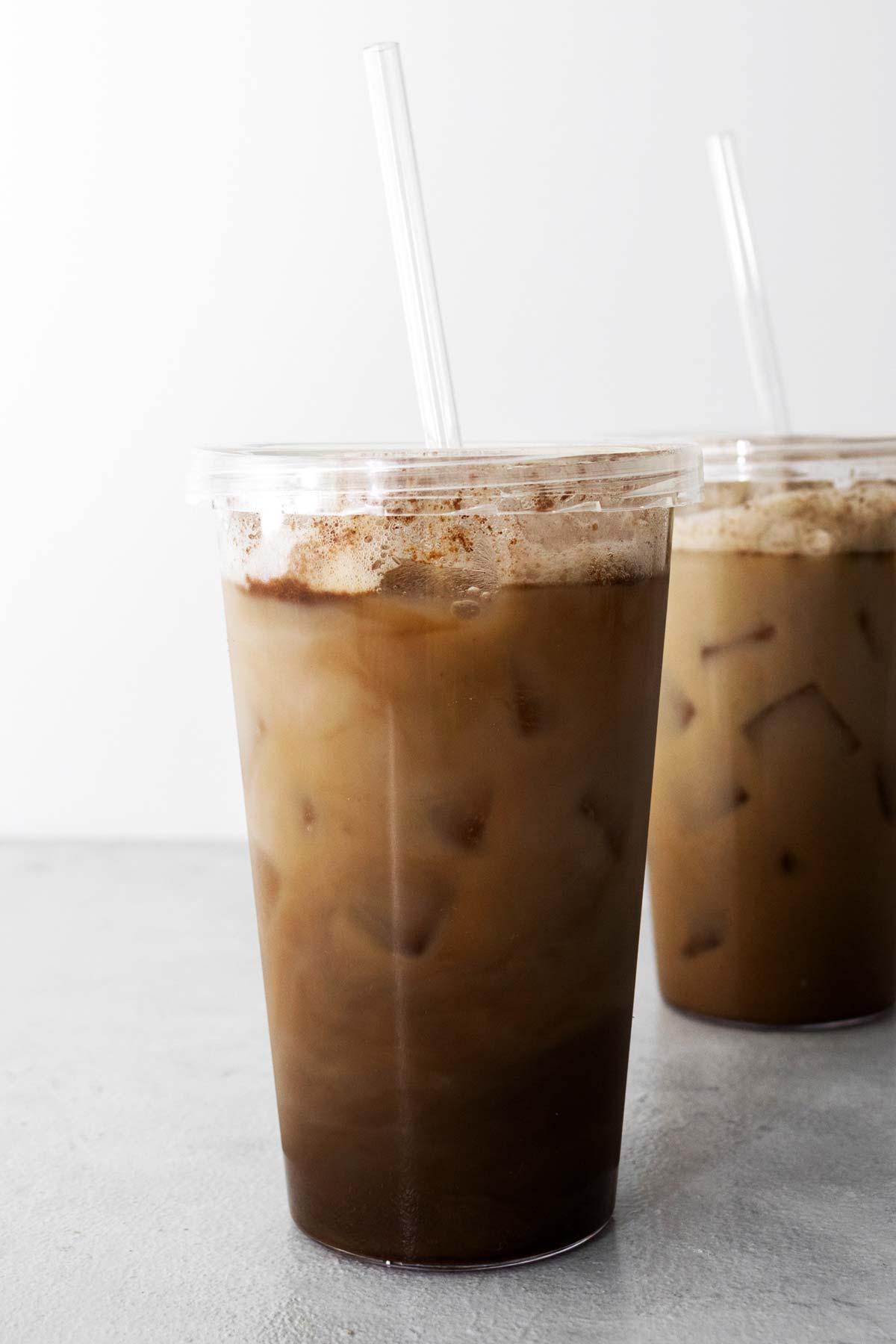Starbucks Iced Brown Sugar Oatmilk Shaken Espresso copycat drink in cups with straws.