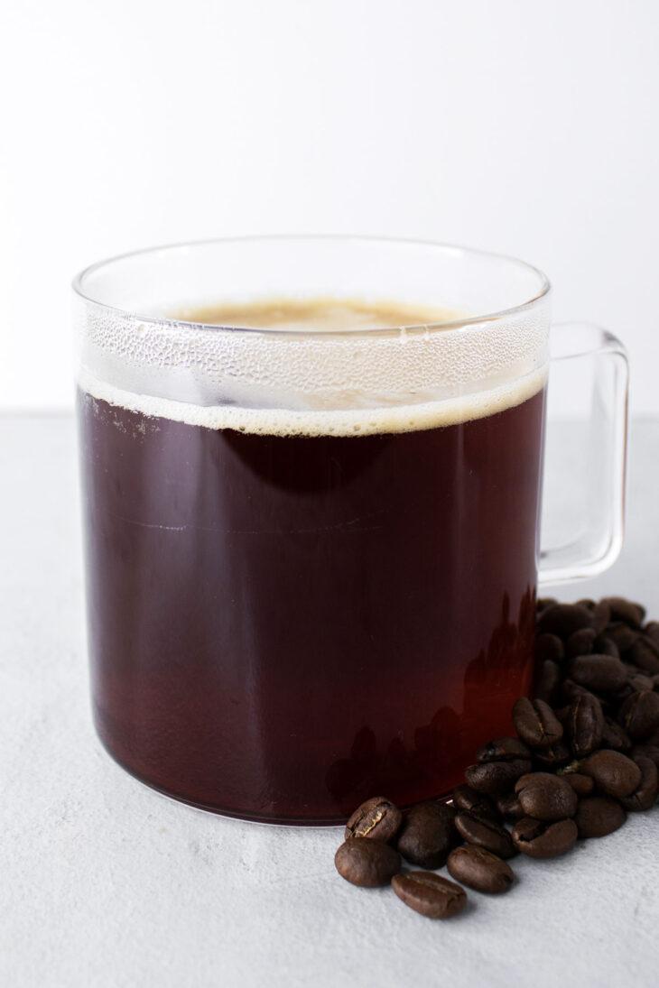 Americano coffee in a glass mug.