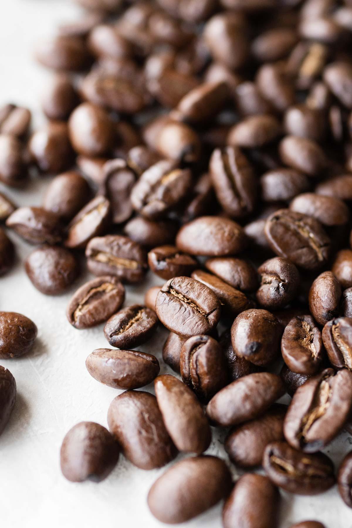 Blonde espresso beans in a pile.