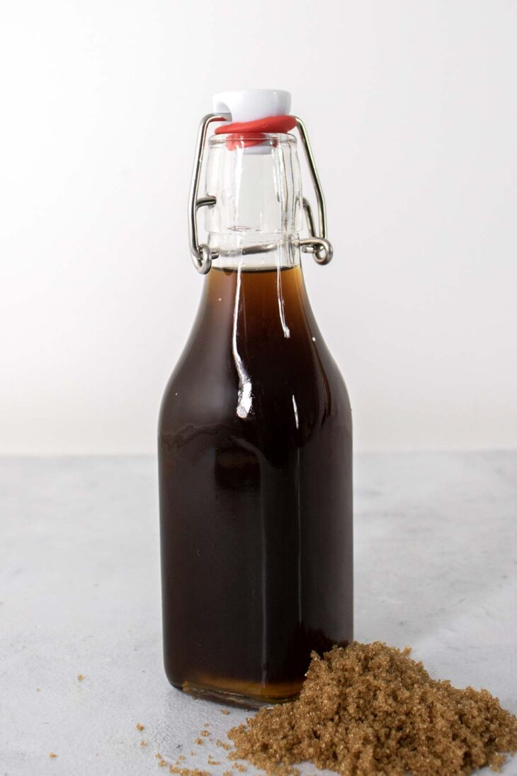 Homemade brown sugar syrup in a glass bottle.