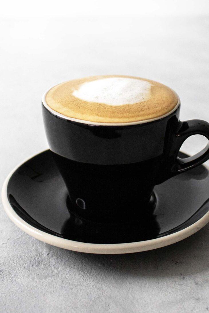 Cappuccino in a black mug.