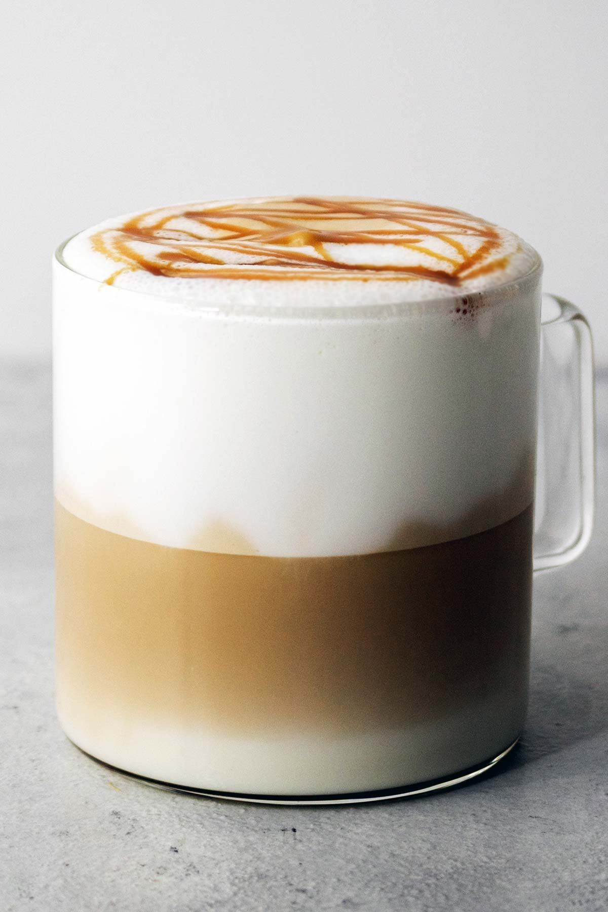 Starbucks Caramel Macchiato drink in a glass mug.