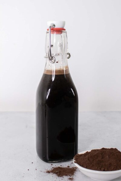 Chocolate syrup in a glass bottle.