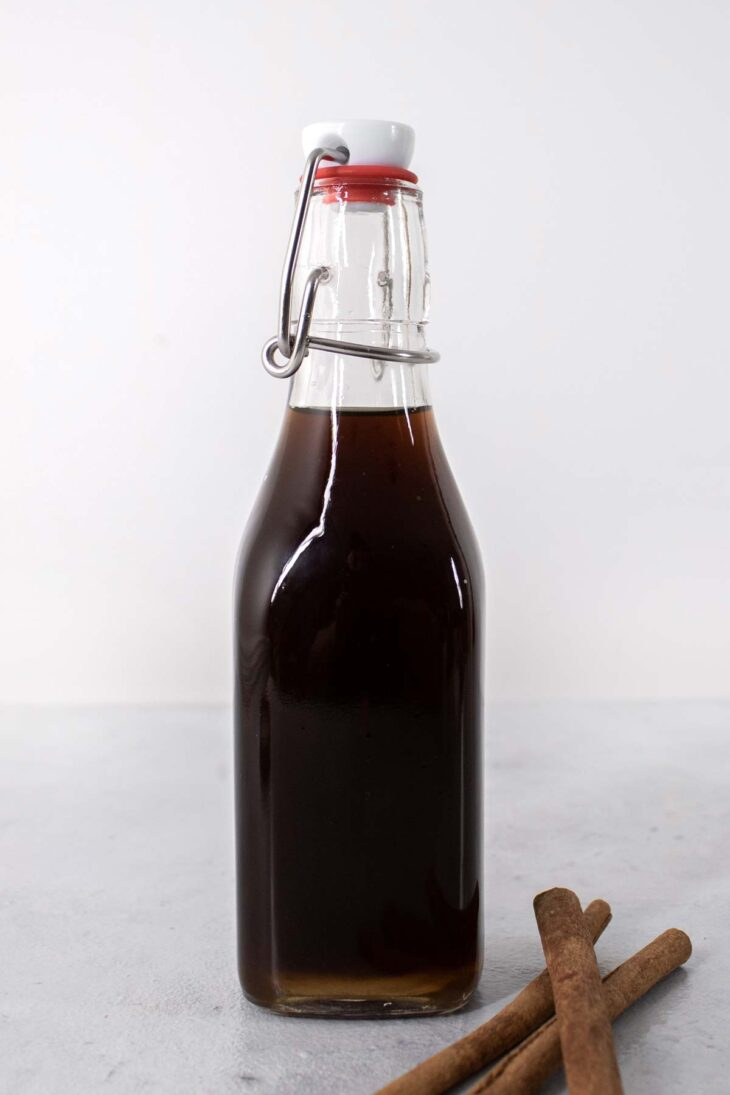 Cinnamon syrup in a glass bottle.