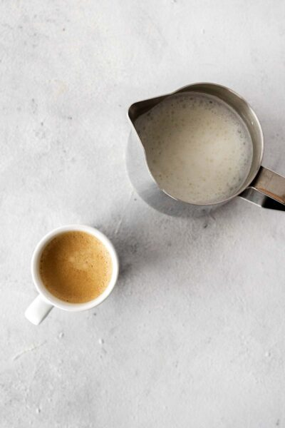 Espresso and steamed milk on a surface.