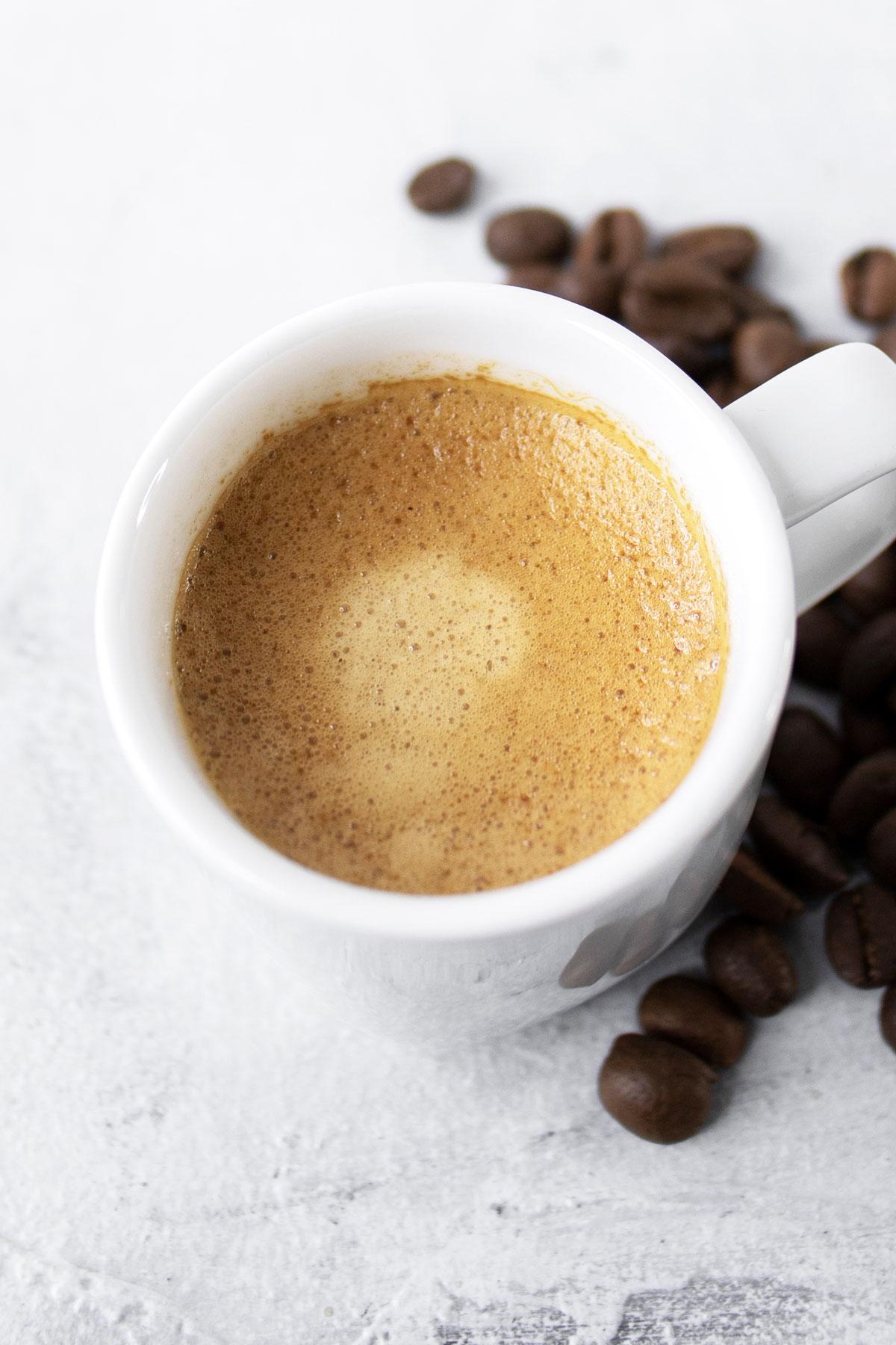 Espresso in a small white mug.