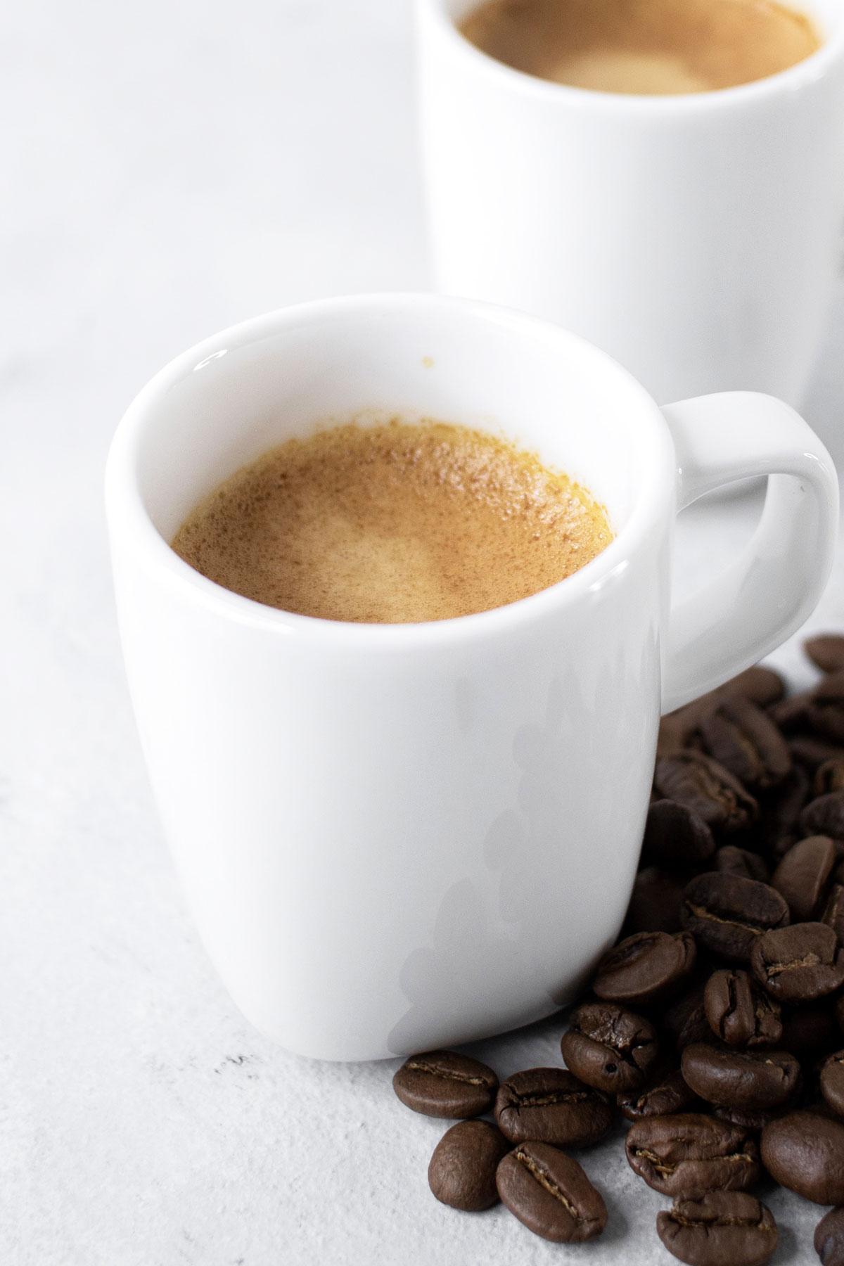 Espresso in small white mugs.