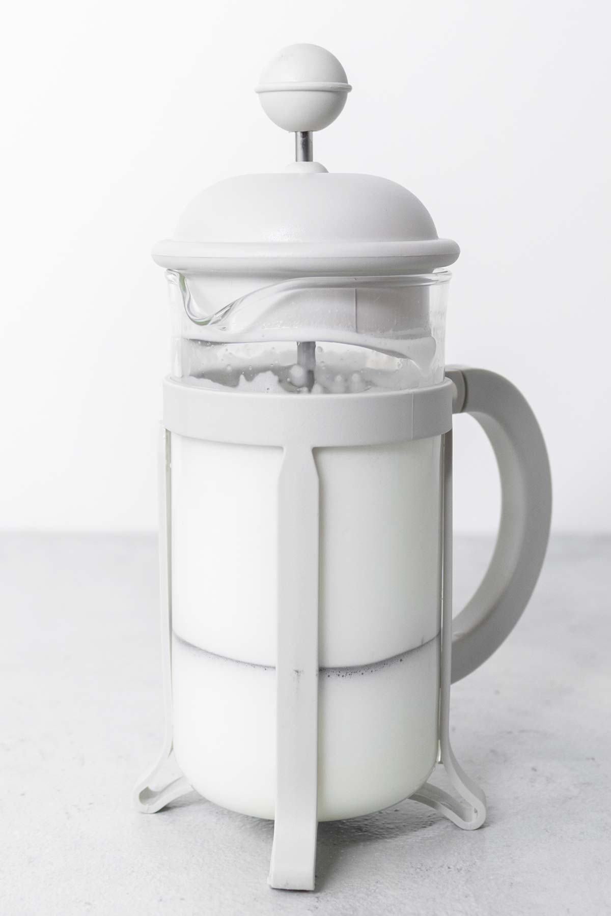 Frothed milk in a French press