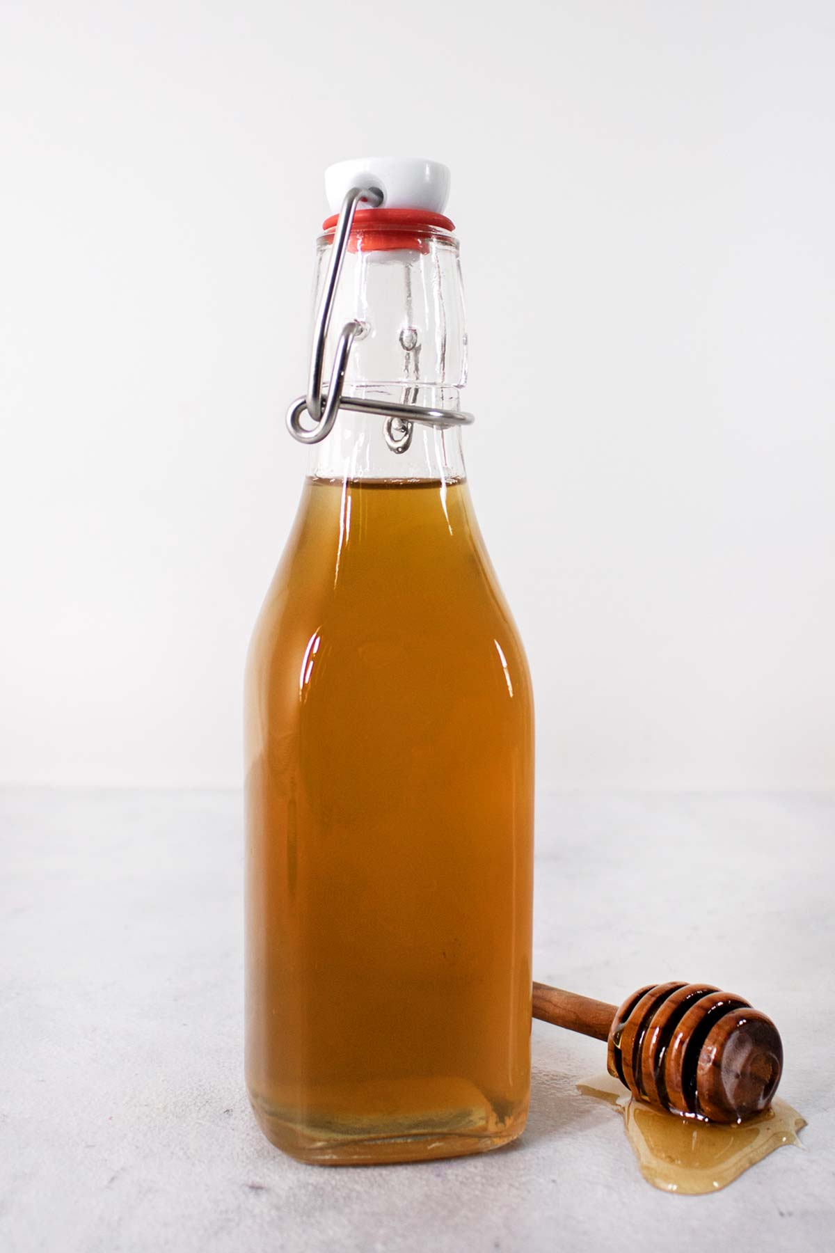 Honey syrup in a glass bottle.