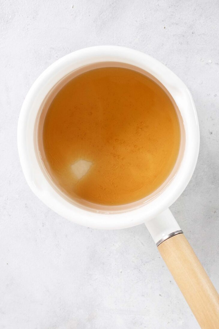 Honey and water in a saucepan.