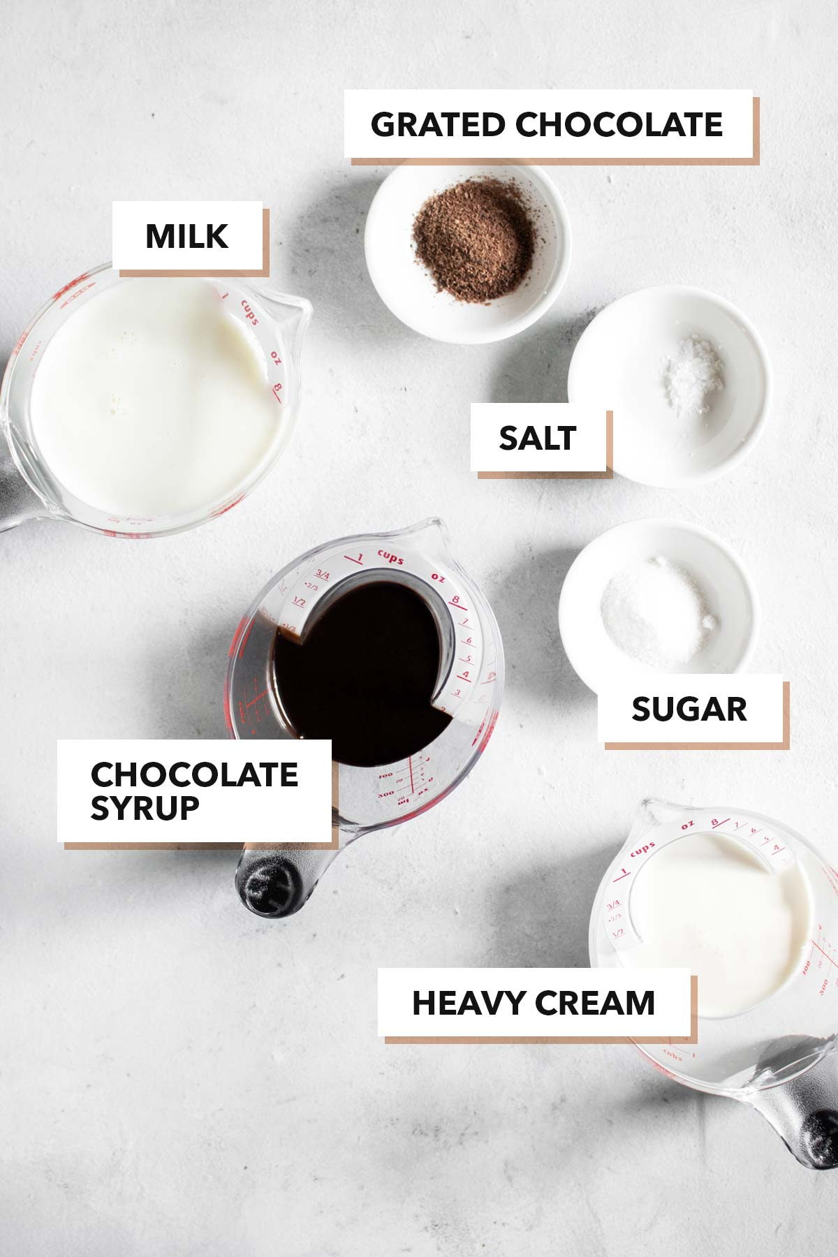 Hot chocolate ingredients on a surface.
