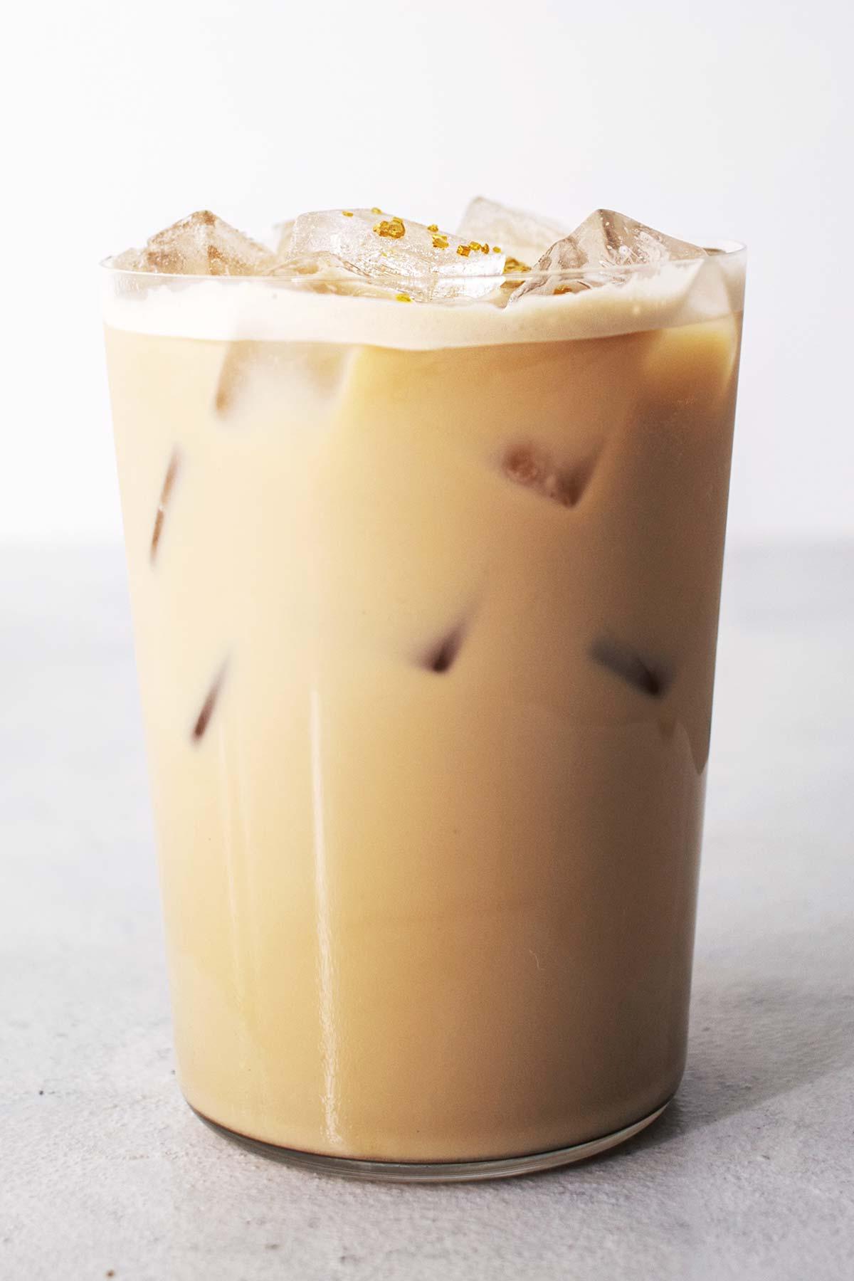 Starbucks Iced Honey Oatmilk Latte copycat drink in a glass cup.