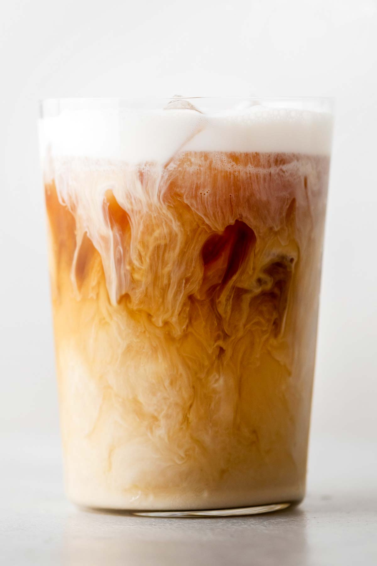 Jameson Cold Brew Irish Whiskey with cold foam in a glass cup.