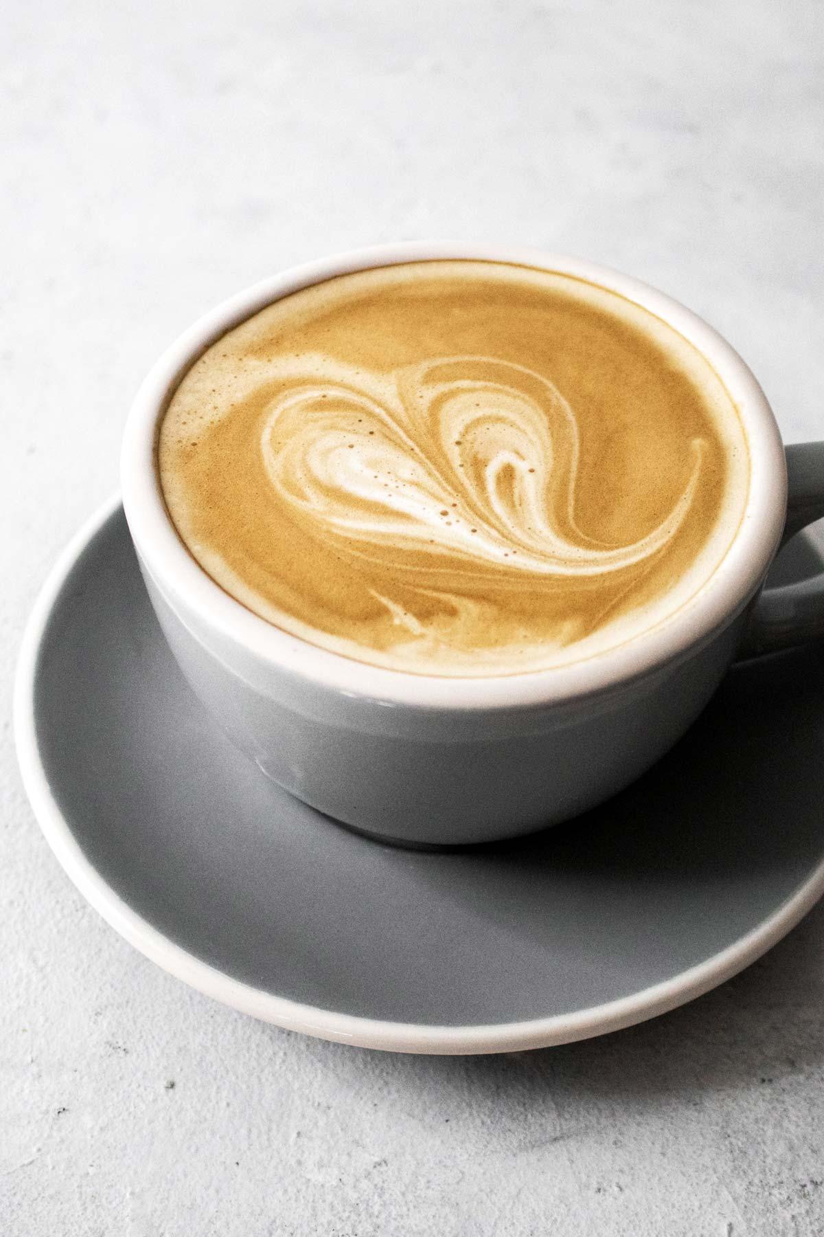 Latte in a grey mug.