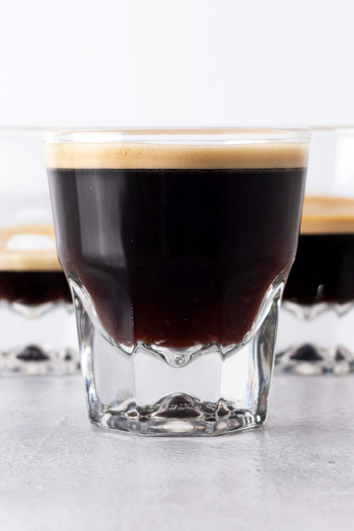 Lungo shots in an espresso cup.