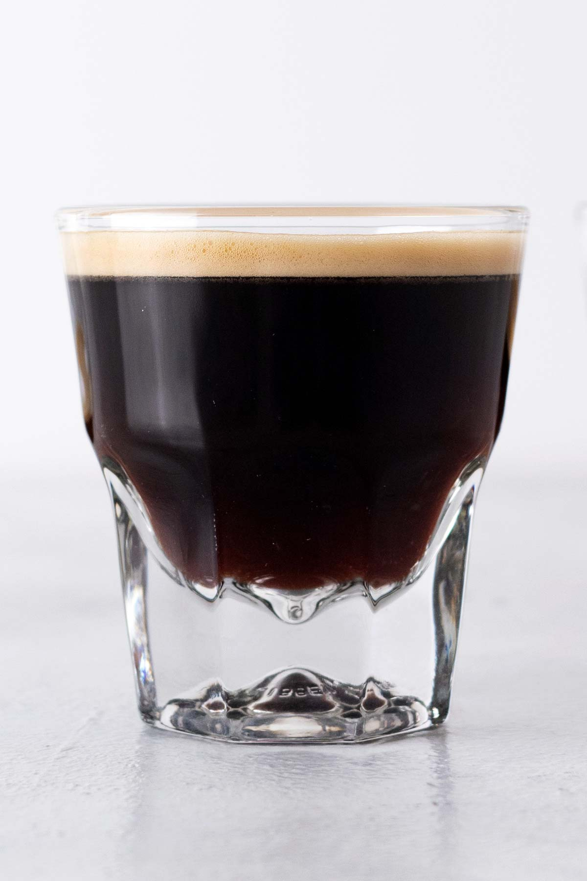 A lungo shot in a glass cup.