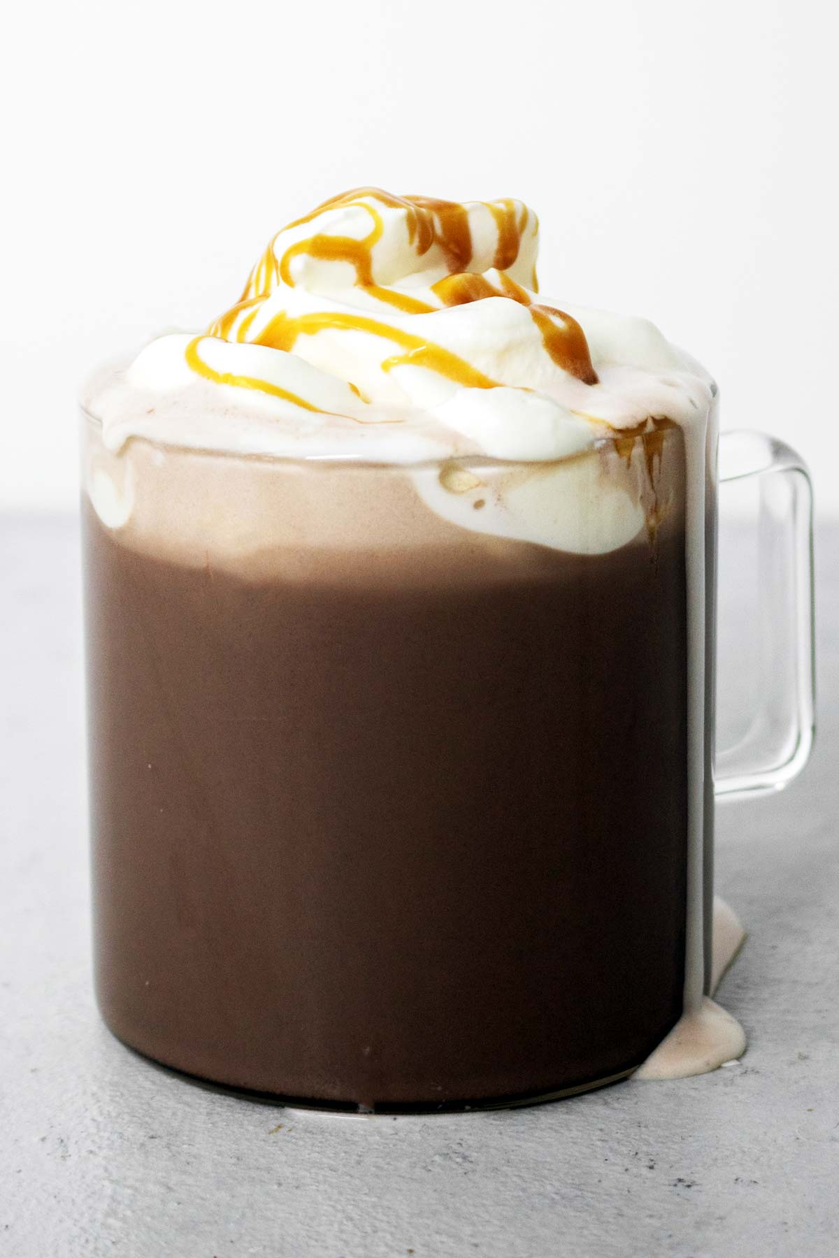 Salted caramel hot chocolate in a mug with whipped cream.