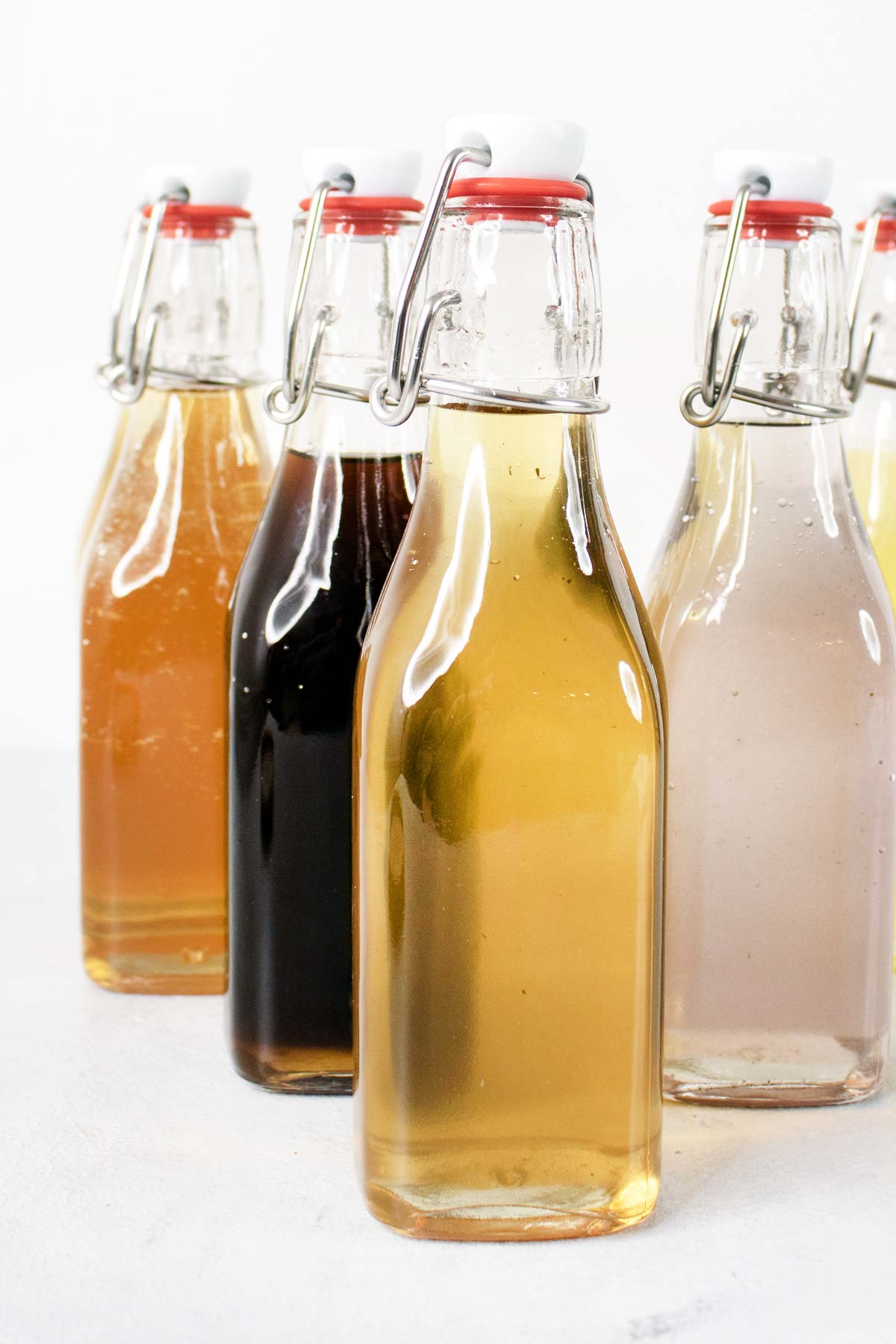Simple syrups in glass bottles.