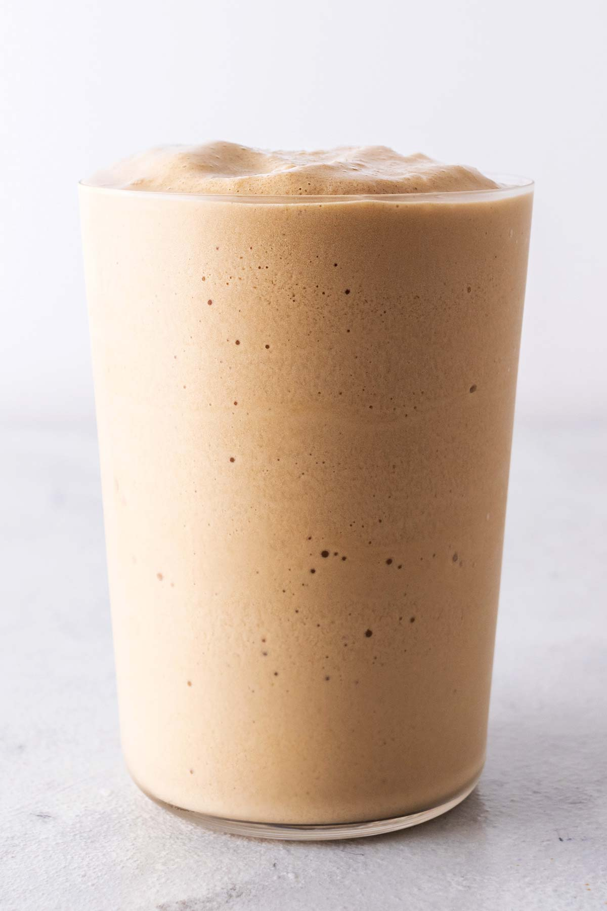 Coffee Frappuccino in a tall cup.
