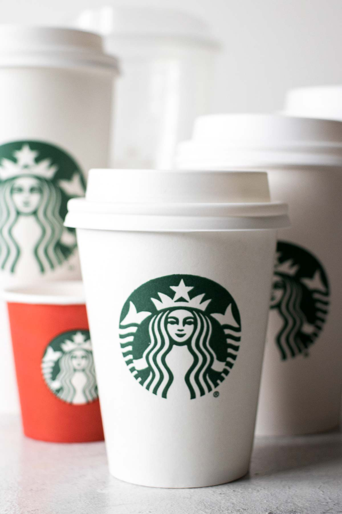 Starbucks cups in different sizes.