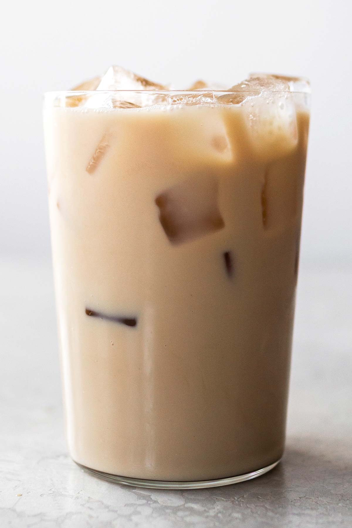 Iced chai tea latte in a cup.