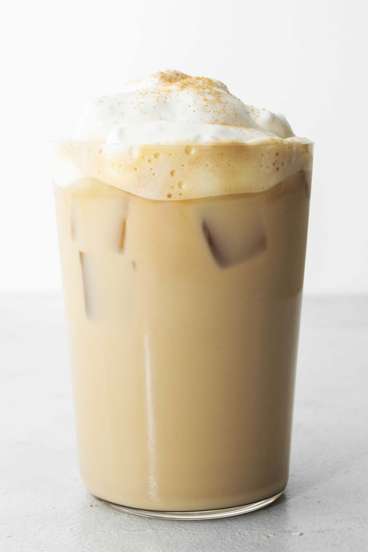 Starbucks Iced Cinnamon Dolce Latte copycat drink in a cup with whipped cream.