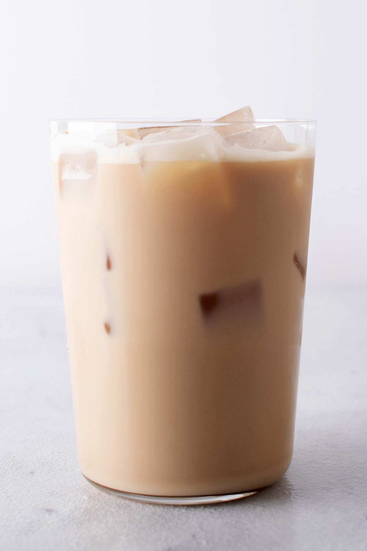 Tall glass with Iced Vanilla Latte.