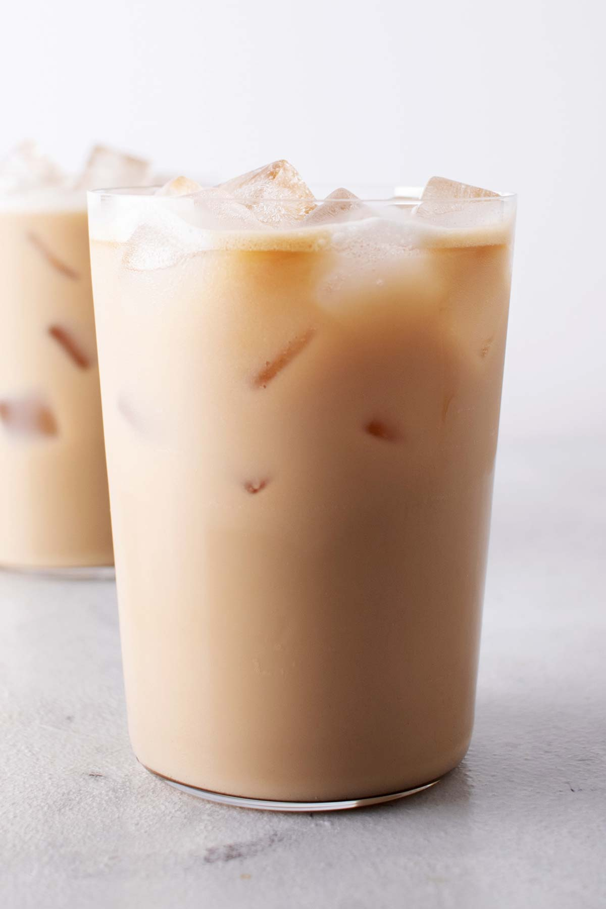 Two glasses filled with Iced Vanilla Latte.