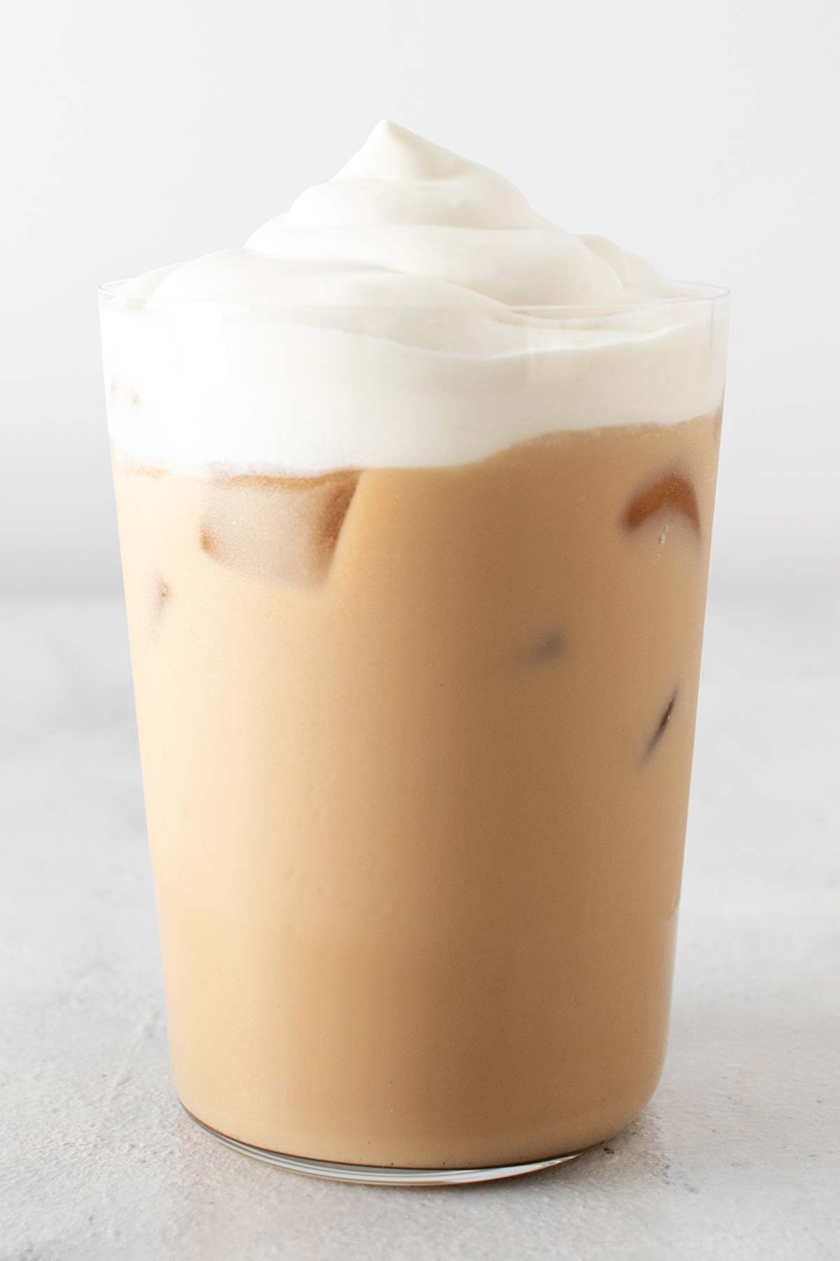 Iced White Chocolate Mocha in a cup with whipped cream.