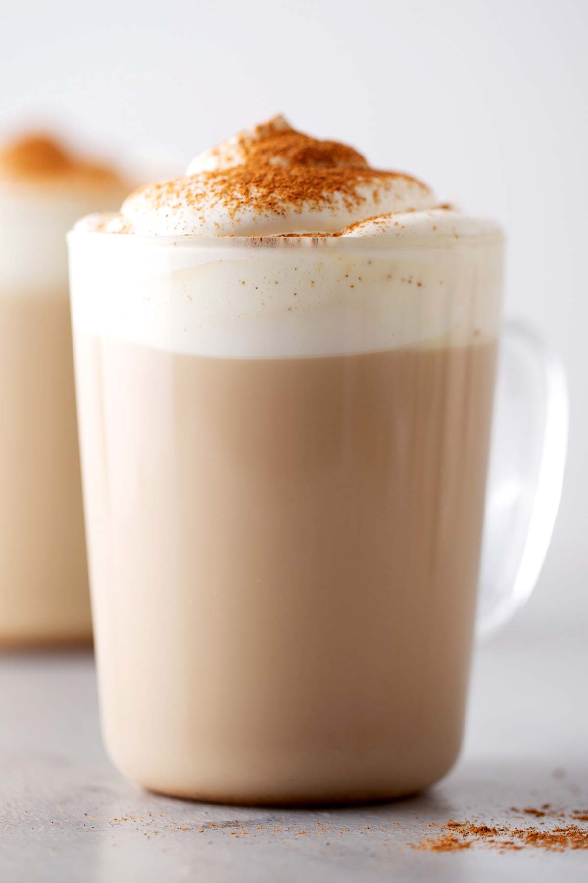 Pumpkin Spice Latte in a cup with whipped cream.