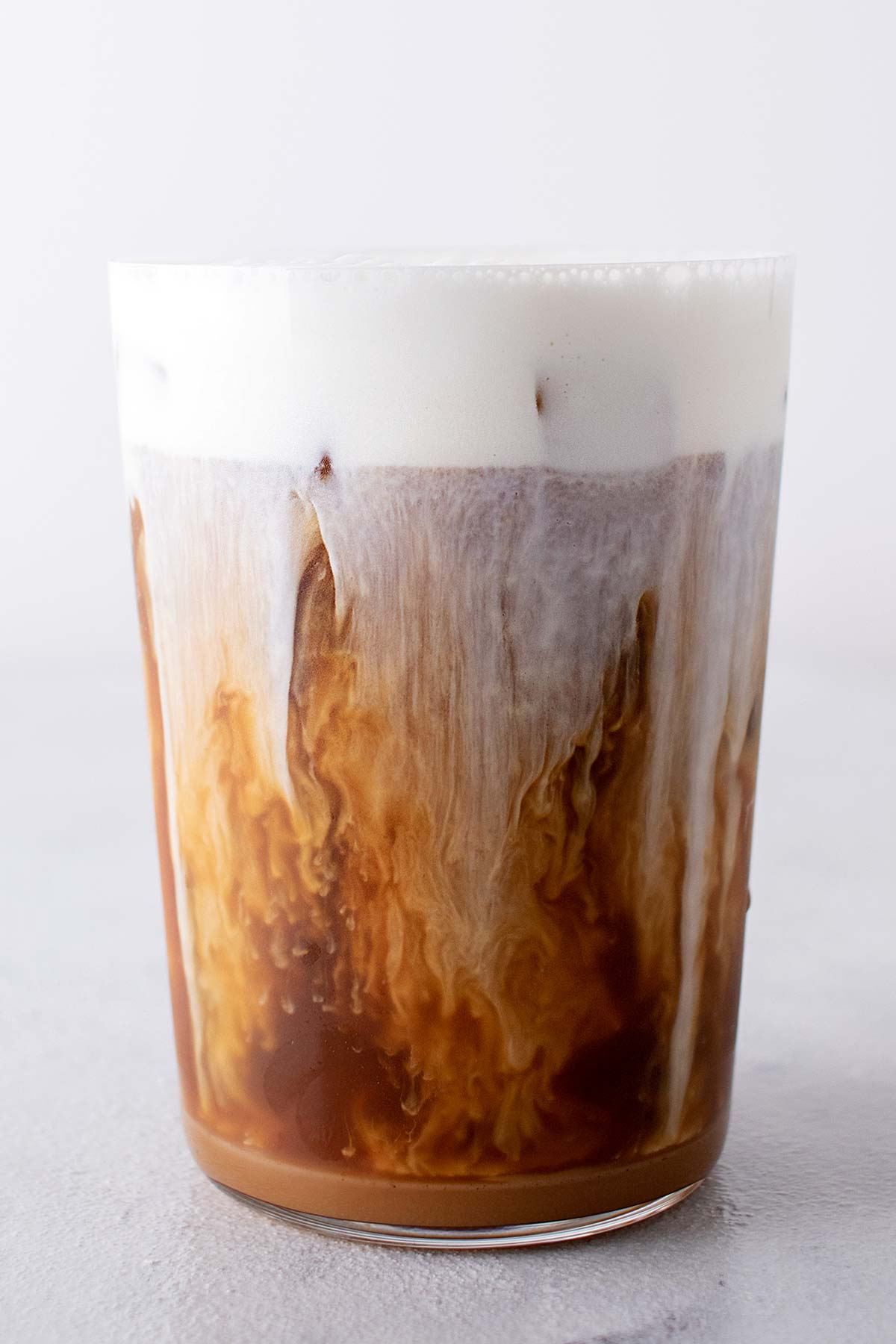 Salted Caramel Cream Cold Brew in a cup with cold foam.