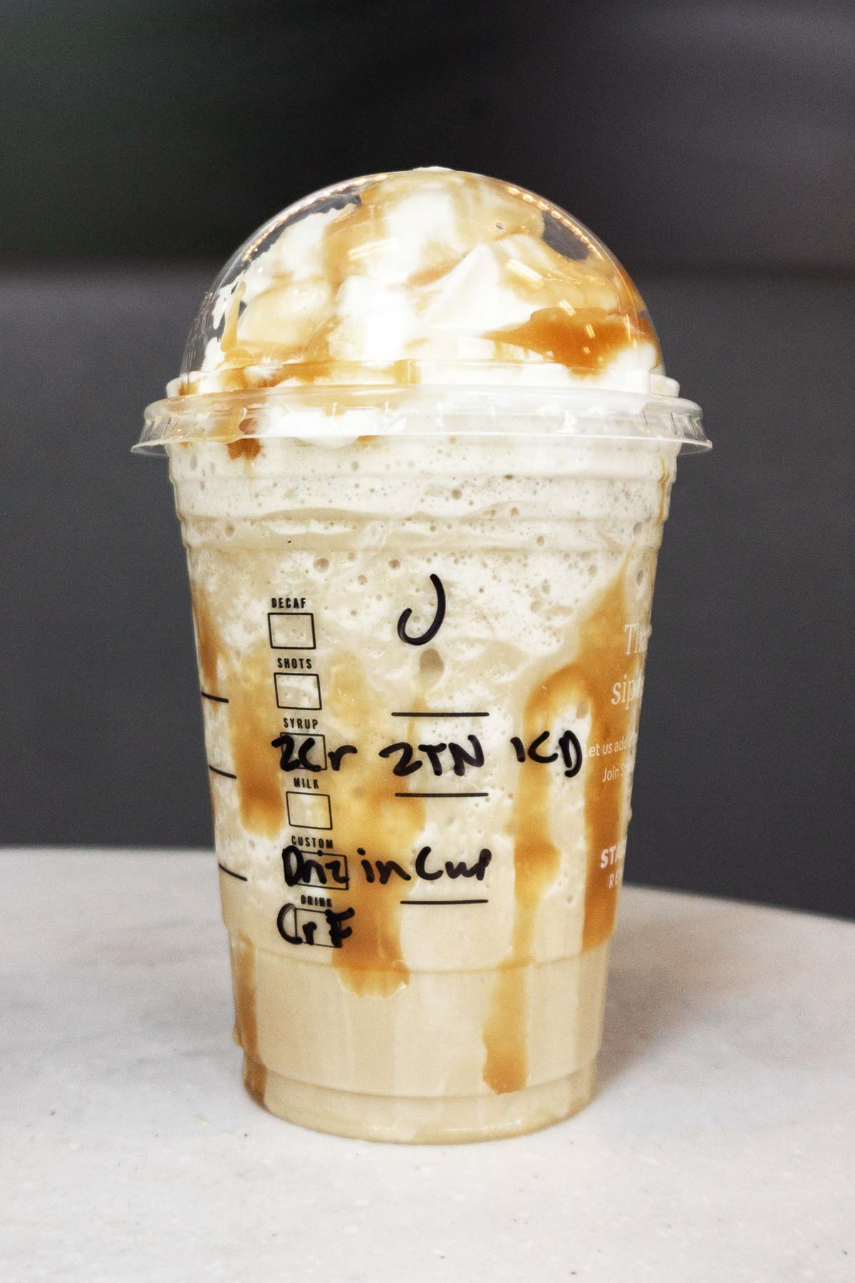 Butterbeer Frappuccino in a cup.