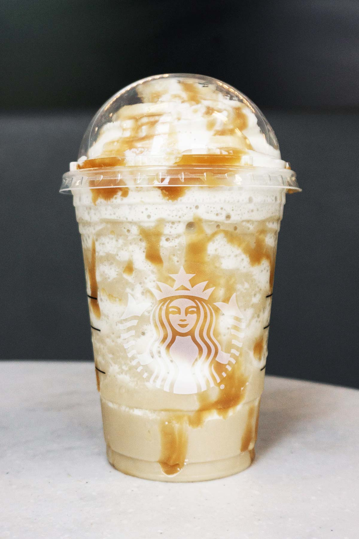 Starbucks Butterbeer Frappuccino in a plastic cup.