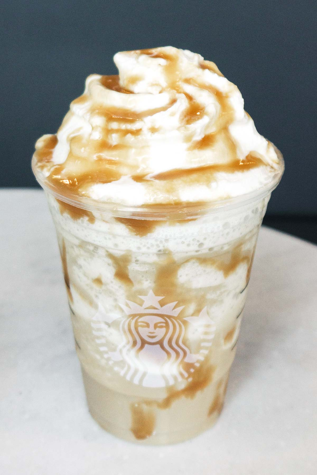 Starbucks Secret Menu Drink Butterbeer Frappuccino in a cup with whipped cream.