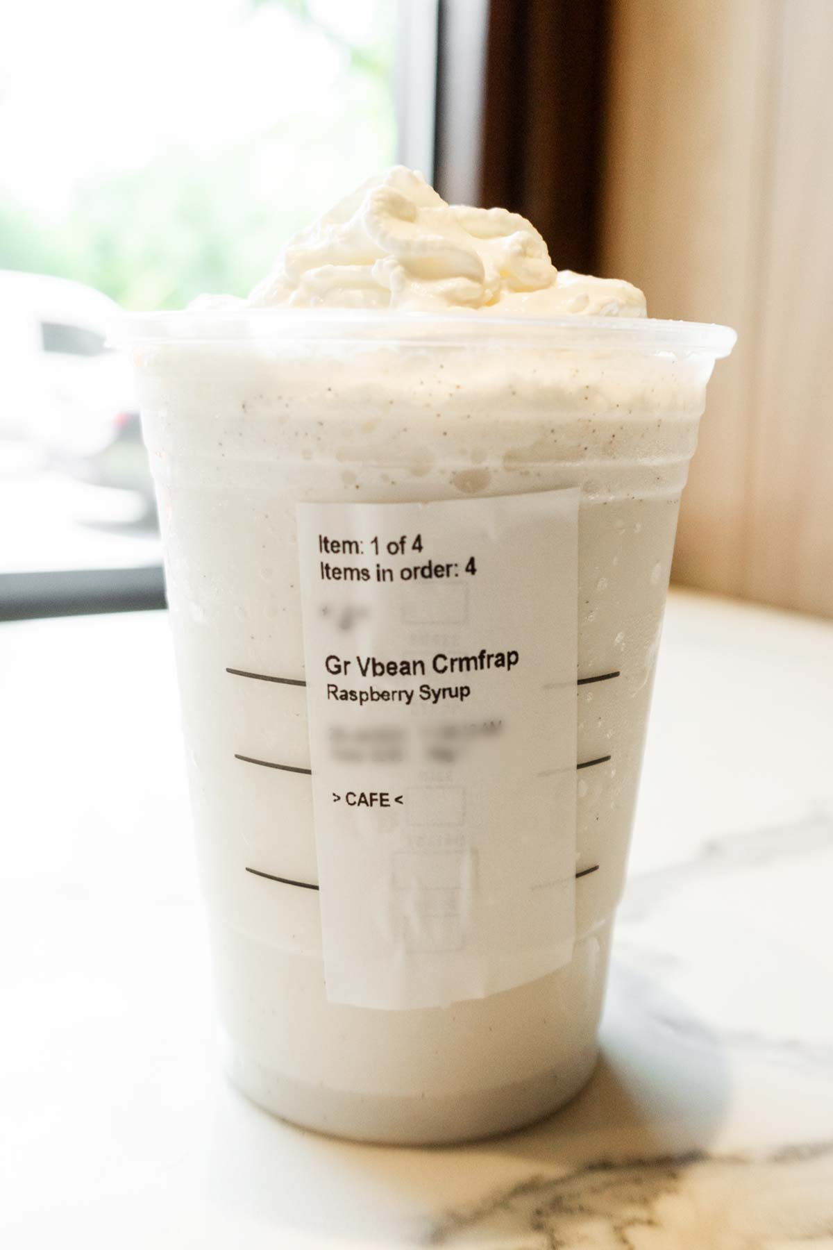 Cotton Candy Frappuccino in a cup with whipped cream.