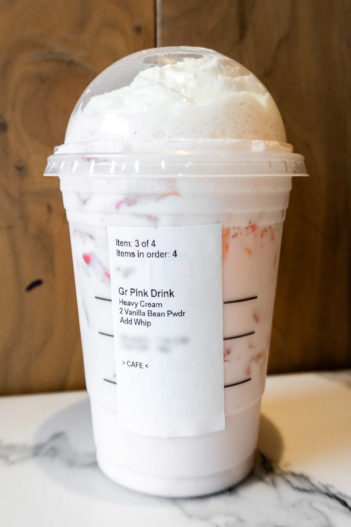 Starbucks TikTok Pink Drink with whipped cream in a cup.