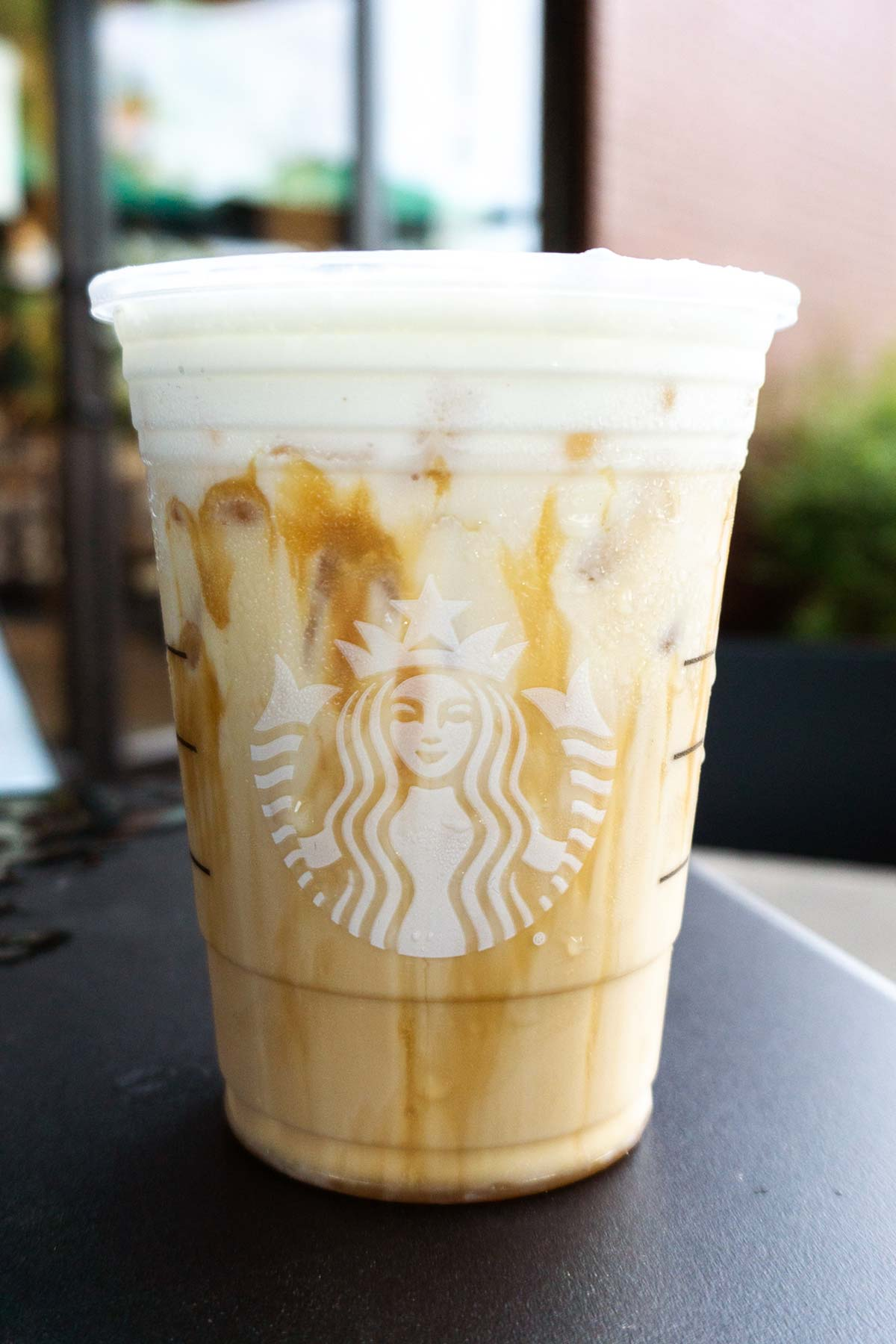 Iced White Mocha with Sweet Cream Foam in a Starbucks cup.