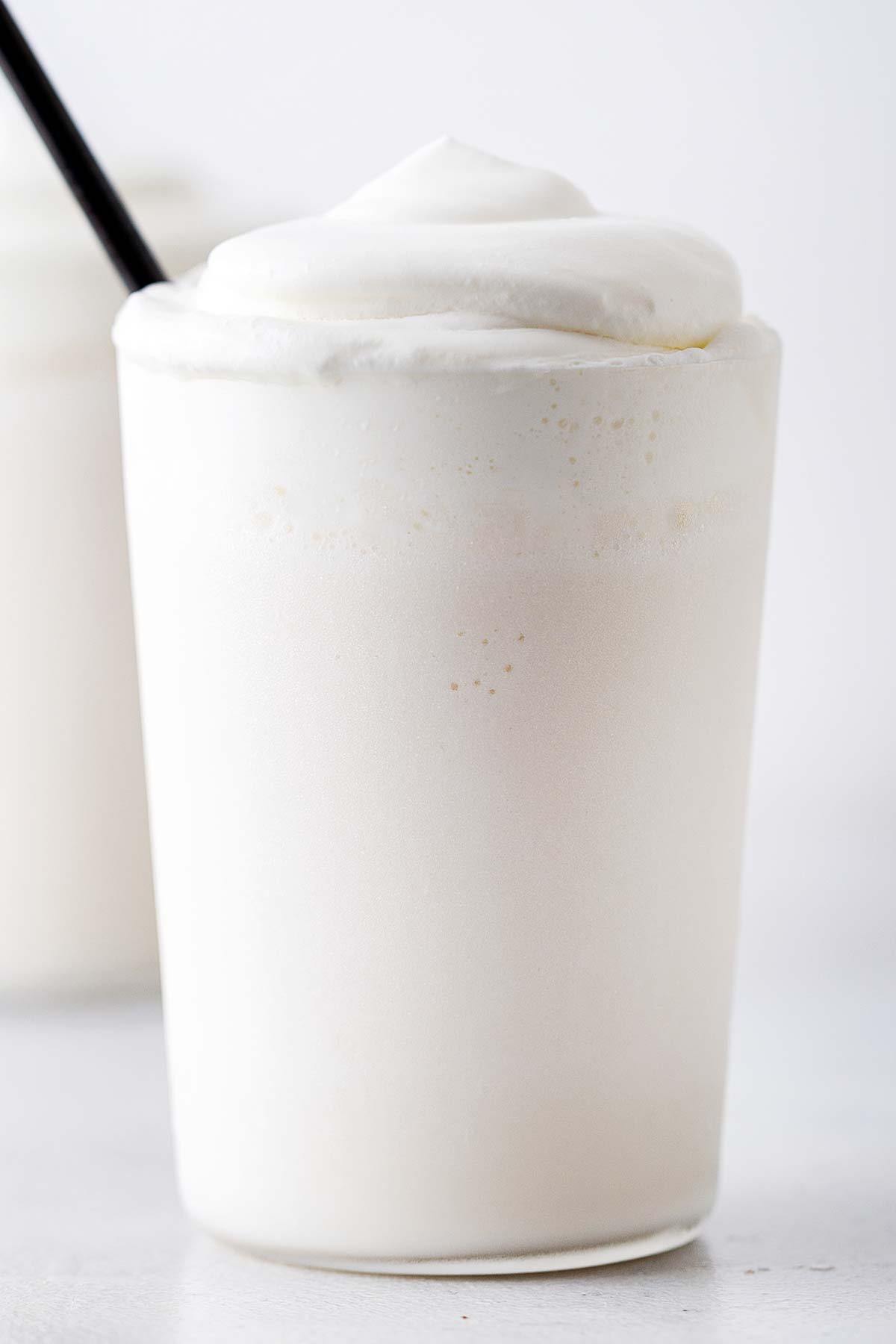 White Chocolate Frappuccino in a cup with whipped cream.
