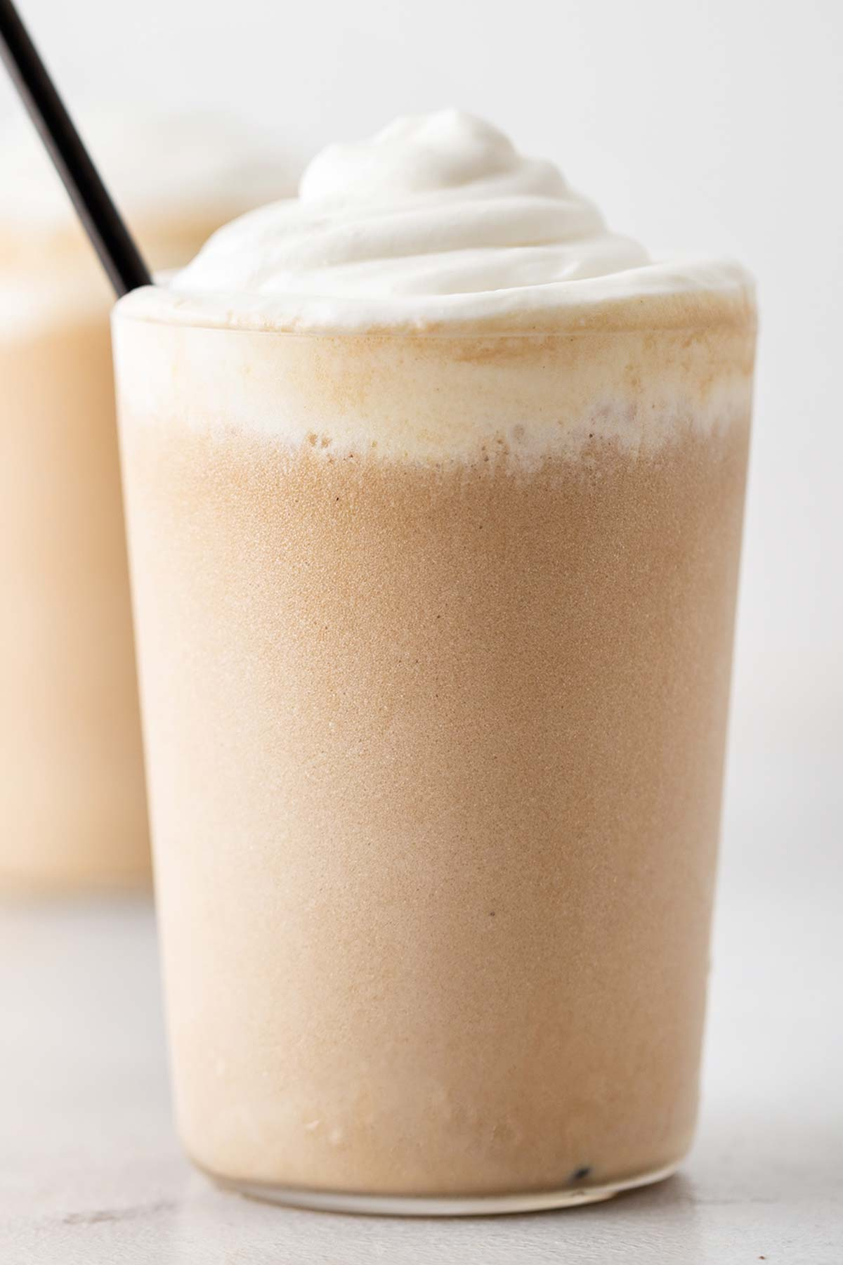 White Chocolate Mocha Frappuccino in a cup with whipped cream.