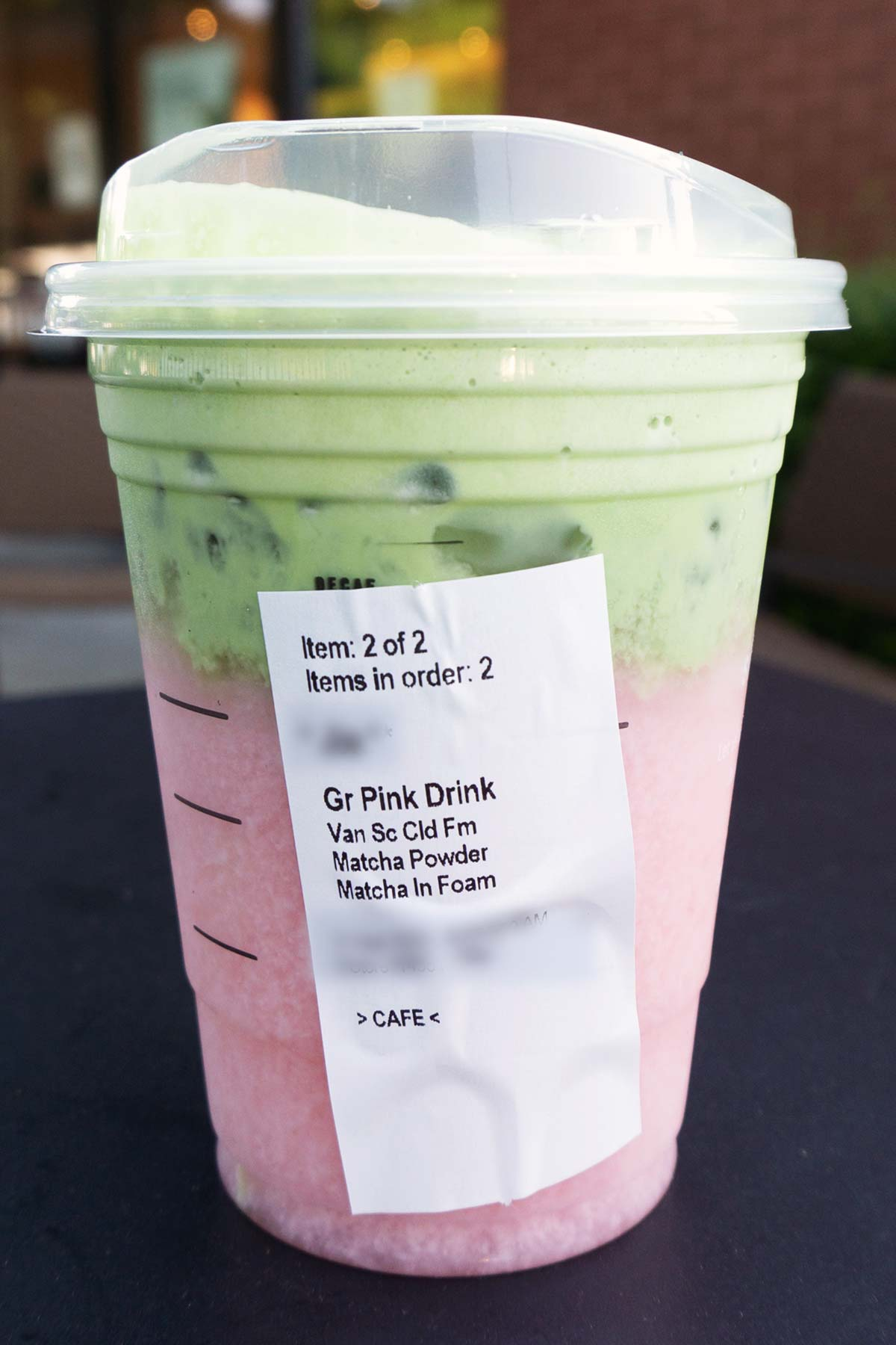 TikTok Matcha Pink Drink in a Starbucks cup with order sticker showing.